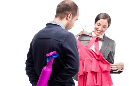 Portrait of adult business man and woman preparing to corporate party. Man gifting cute dressand wine to his colleague. photo