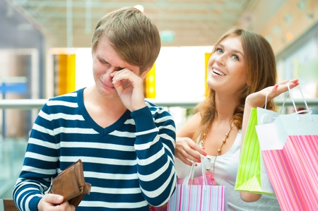 Woman can`t stop shopping at mall, making her man or boyfriend spent all his money and crying photo