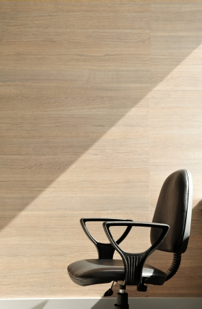 quiting: Portrait of an office chair facing the left.  Office background. Stock Photo