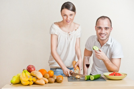 Young love couple cooking. Big copyspace photo
