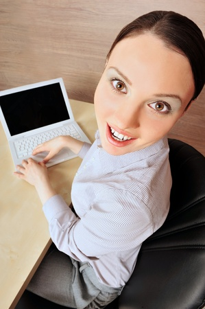 coporate: Portrait of a beautiful young businesswoman smiling at the camera on the left.