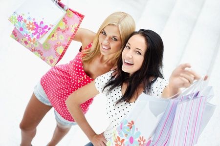 Group of beautiful shopping women with bags and smiling photo