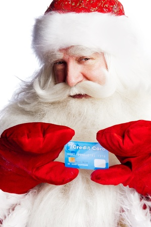 st nick: Traditional Santa Claus holding and sowing credit card while giving a big ho ho ho belly laugh. Isolated on white.