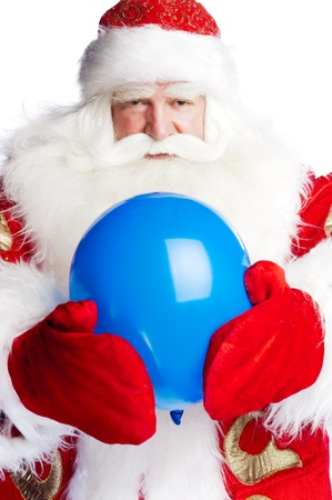 Traditional Santa Claus holding balloons for children. Isolated on white. Stock Photo