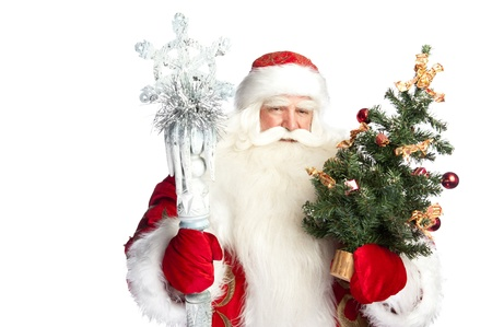 bawl: Christmas theme: Santa Claus holding christmas tree? staff and his bag full of gifts over white background Stock Photo