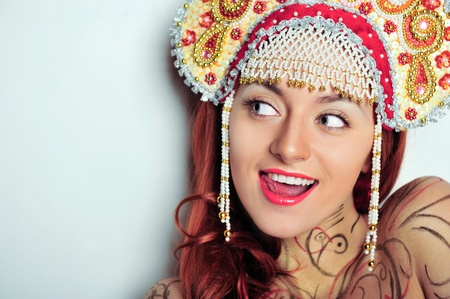 kokoshnik: Closeup portrait of young beautiful woman wearing russian traditional hat kokoshnik. Advertisement banner for beauty and fashion industry with copyspace