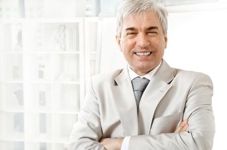 Portrait of an older businessman. Office background.