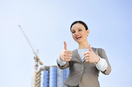 coporate: Portrait of a beautiful young businesswoman celebrating. Stock Photo