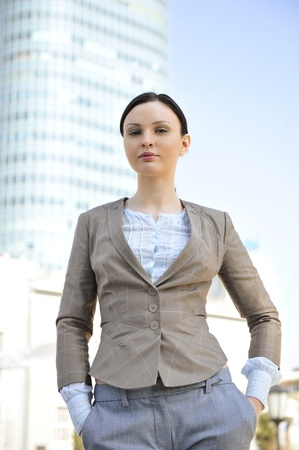 coporate: Portrait of a beautiful young businesswoman outside.