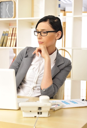 coporate: Portrait of a beautiful young businesswoman working. Office background.