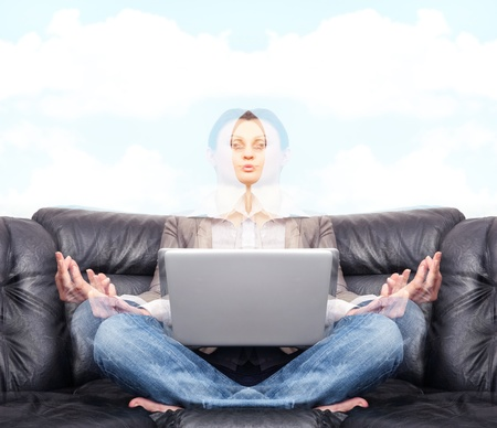 Portrait of young business woman sitting with a laptop and meditating, going away in astral photo