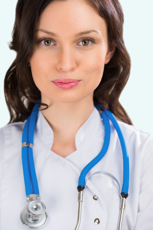 Closeup portrait of adult female doctor with kind look at hospital photo