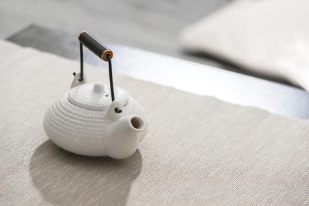 Asian tea pot at comfortable lounge photo