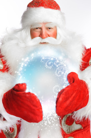 bawl: Traditional Santa Claus holding magic snowball Isolated on white Stock Photo