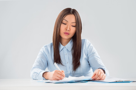 View of pretty business woman focusing on business plan photo
