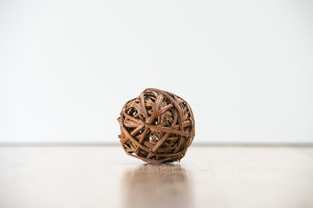 entwined: Tangled single wooden old knot sphere. Depression and crisis concept.