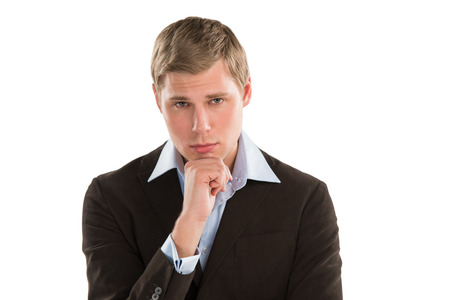 A thoughtful young executive gazing cuusly at copyspace while isolated on white Stock Photo - 27108294