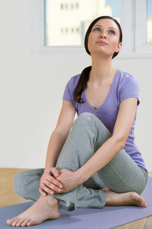 Portrait of beautiful young woman relaxing after doing exercise photo