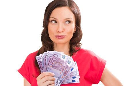 Woman holding and showing a lot of five hundred euro banknotes on a white isolated background photo