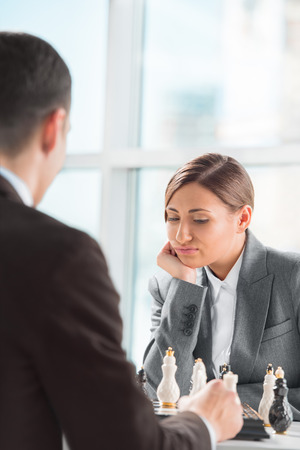 Business people playing chess at office. Business strategy concept photo