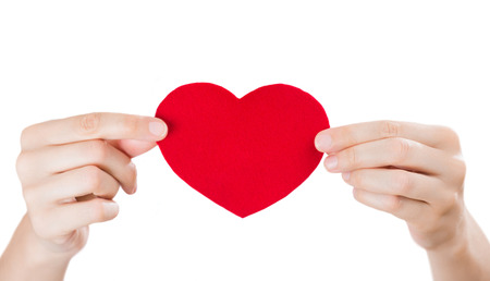 Two arms holding red fabric heart. Valentines day or medical services concept photo