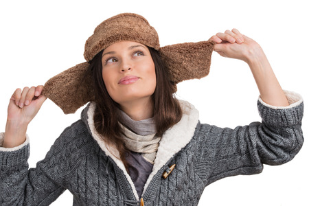 Winter woman posing at white background and having fun photo