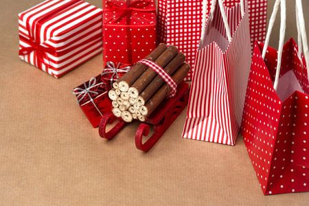 Christmas background with red and natural decorations, gift boxes, little bags with presents photo