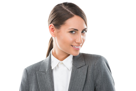 Portrait of happy Caucasian business woman standing over white background photo