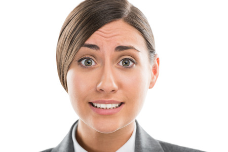 Portrait of shocked and confused business woman on white background photo