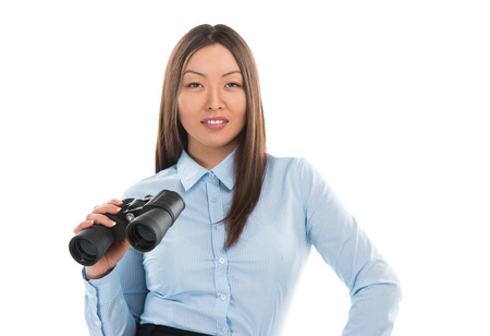 Pretty asian business woman holding binocular isolated on white background photo