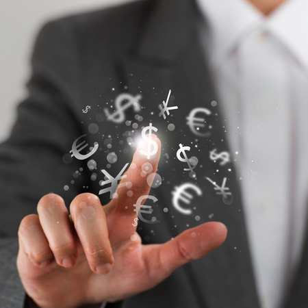 Investment concept. Pretty business woman with currency symbols. photo