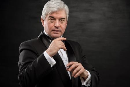 hypnotist: Portrait of professional hypnotist on black background