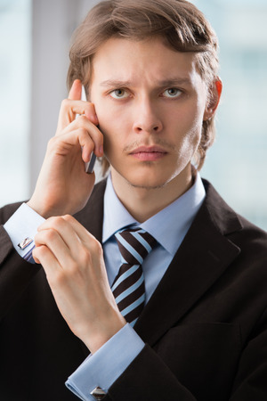 Closeup portrait of handsome business man using cell phone, smiling Stock Photo - 27108622