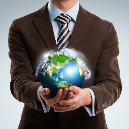 Businessman keeps the world in his hands Stock Photo - 27006867