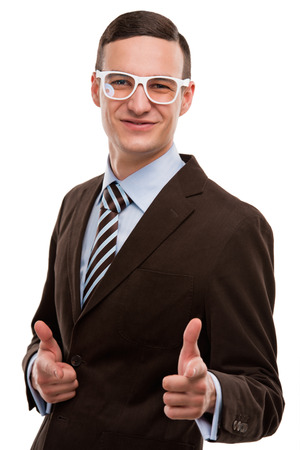 Portrait of a handsome young business man in gesture of reaching the goal against white background photo