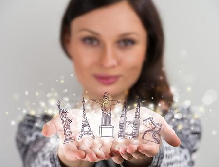 Closeup portrait of woman sharing virtual symbols of famous touristic destinations. Touristic service concept photo