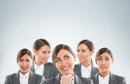 clones: Group of business women clones with different emotions Stock Photo