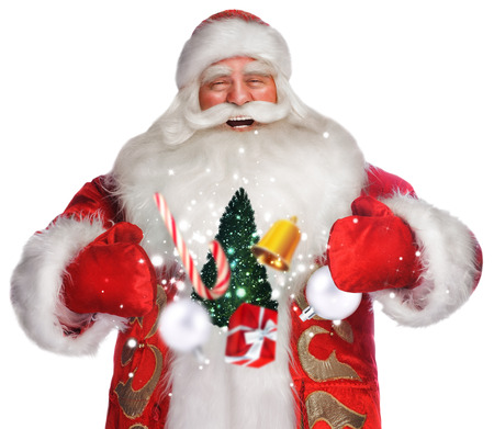 Laughing Santa Claus standing on white backgound and doing magic photo
