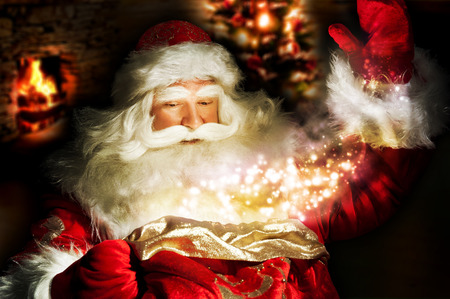 elder tree: Santa Claus at home at night making magic