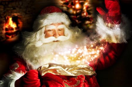 santa: Santa Claus at home at night making magic