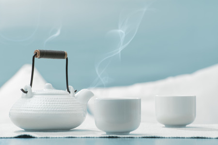 teaset: Teapot and cups on table at comfortable relaxation lounge