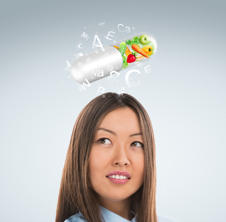 microelements: Healthy life concept. Woman with vitamins overhead