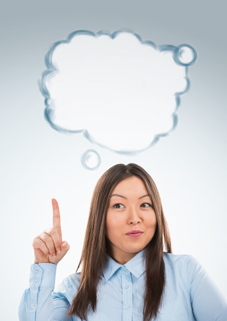 Beautiful asian business woman have good idea, including thought bubble with copy space on grey background photo