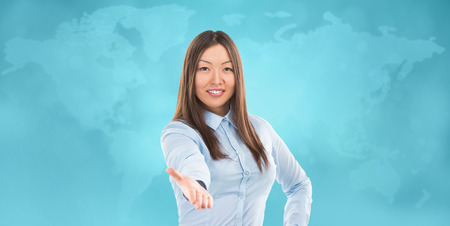 Portrait of lovely business woman offering handshake over world map on background photo