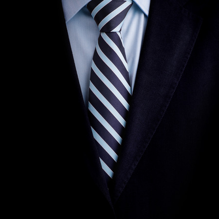 dress form: Black business suit with a tie background Stock Photo
