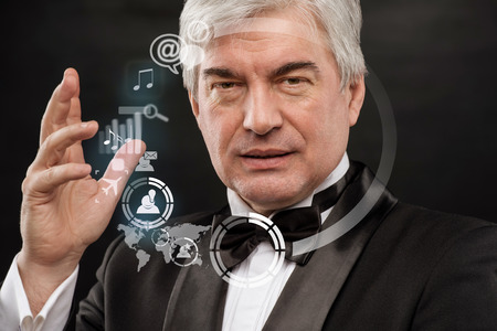 Technology concept. Businessman and virtual interface with web and social media icons photo
