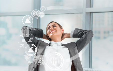 Technology concept. Businesswoman and virtual interface with web and social media icons photo