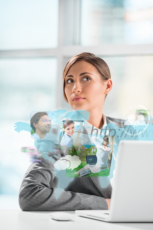 Business woman surfing on web with modern laptop photo