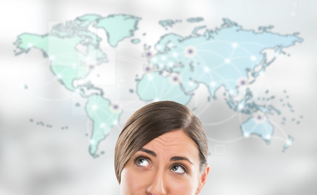 Portrait of young woman standing in front of big world map. Server locations and actual online connections are displayed on virtual map. Hosting provider concept.