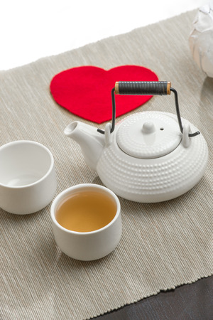 Valentines day surprice for couple. Romantic tea set with red heart photo